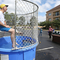 Lauren Wood | Buy at photos.djournal.com<br /> David Brevard, president of B & B Concrete, waits in the dunk tank as his son-in-law Victor McMillan Thursday morning during the Dunk A Boss fundraiser at the Courtyard by Marriott hotel. Proceeds from the fundraiser will benefit Habitat for Humanity.