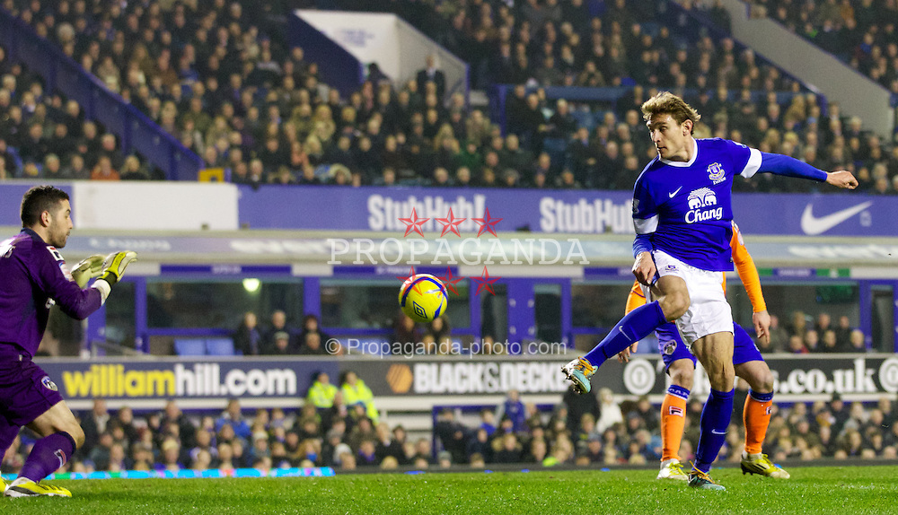 LIVERPOOL, ENGLAND - Tuesday, February 26, 2013: Everton's Nikica Jelavic sees his side score their third goal past Oldham Athletic's goalkeeper Dean Bouzanis during the FA Cup 5th Round Replay match at Goodison Park. (Pic by Vegard Grott/Propaganda)