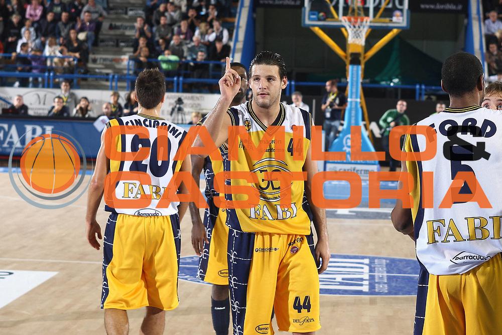 DESCRIZIONE : Porto San Giorgio Lega A 2010-11 Fabi Montegranaro Dinamo Sassari <br /> GIOCATORE : Dejan Ivanov<br /> SQUADRA : Fabi Montegranaro<br /> EVENTO : Campionato Lega A 2010-2011<br /> GARA : Fabi Montegranaro Dinamo Sassari <br /> DATA : 17/10/2010<br /> CATEGORIA : esultanza<br /> SPORT : Pallacanestro<br /> AUTORE : Agenzia Ciamillo-Castoria/C.De Massis<br /> Galleria : Lega Basket A 2010-2011<br /> Fotonotizia : Porto San Giorgio Lega A 2010-11 Fabi Montegranaro Dinamo Sassari <br /> Predefinita :