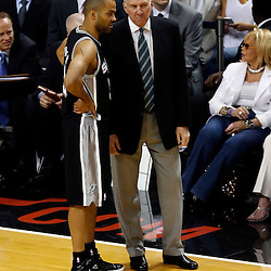Jun 6, 2013; Miami, FL, USA; San Antonio Spurs head coach Gregg Popovich talks to Tony Parker (9) against the Miami Heat in the first quarter during game one of the 2013 NBA Finals at the American Airlines Arena. Mandatory Credit: Derick E. Hingle-USA TODAY Sports