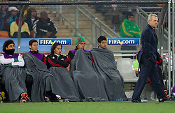 Substitutes and Coach of Mexico Javier Aguirre (R)  during the 2010 FIFA World Cup South Africa Round of Sixteen match between Argentina and Mexico at Soccer City Stadium on June 27, 2010 in Johannesburg, South Africa. (Photo by Vid Ponikvar / Sportida)