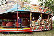 Teenager Leaning On Fairground Ride
