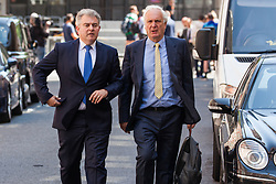 London, UK. 23 July, 2019. Brandon Lewis (l), Chairman of the Conservative party, arrives at the party's headquarters with Sir Edward Lister (r) following the announcement that Boris Johnson had been elected as the party leader and would replace Theresa May as Prime Minister.