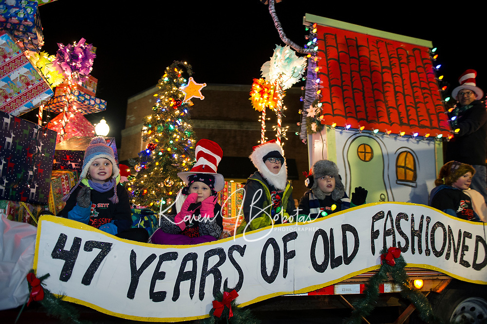 """The Streetcar Theater Company """"47 years of old fashioned family fun"""" float rolls down Main Street during the """"Light Up Laconia"""" Holiday Parade Sunday evening.  (Karen Bobotas/for the Laconia Daily Sun)"""