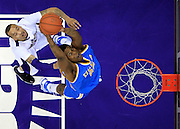 Washington's Venoy Overton, left, watches as UCLA's J'mison Morgan, rebounds the ball, during the first half of a NCAA college basketball game, in Seattle, on Saturday, Feb. 20, 2010. (AP Photo/Kevin P. Casey)