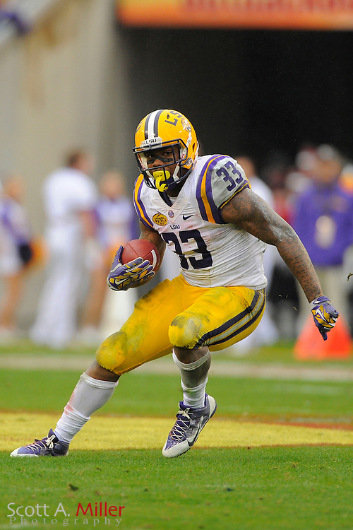 LSU Tigers  running back Jeremy Hill (33) during LSU's 21-14 win over the Iowa Hawkeyes in the 2014 Outback Bowl at Raymond James Stadium on Jan 1, 2014  in Tampa, Florida. ©2014 Scott A. Miller