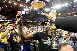 The Golden State Warriors' Kevin Durant carries his MVP trophy as he celebrates with fans a championship after defeating the Cleveland Cavaliers, 129-120, in Game 5 of the NBA Finals at Oracle Arena in Oakland, Calif., on Monday, June 12, 2017. (Photo by Ray Chavez/Bay Area News Group/TNS) *** Please Use Credit from Credit Field ***