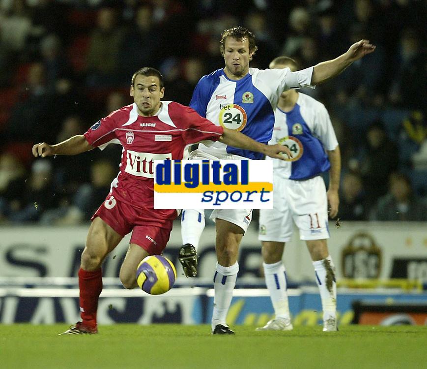 Photo: Aidan Ellis.<br /> Blackburn Rovers v AS Nancy. UEFA Cup. 13/12/2006.<br /> Rovers Lucas Neill challenges Nancy's Pascal Berenguer