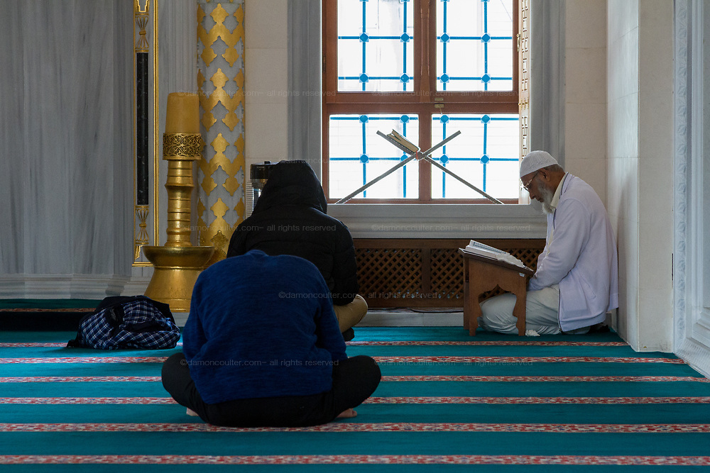 A Muslim Imam gives a service during Friday Prayers at Tokyo Camii mosque in Yoyogi Uehara, Tokyo, Japan. Friday March 22nd 2019.   The Tokyo Camii Mosque is the largest mosque in Japan where estimate currently put the immigrant and native population of Muslims at around 130,000.