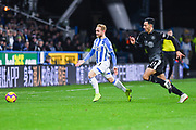 Alex Pritchard of Huddersfield Town (21) and Dwight McNeil of Burnley (31) in action during the Premier League match between Huddersfield Town and Burnley at the John Smiths Stadium, Huddersfield, England on 2 January 2019.