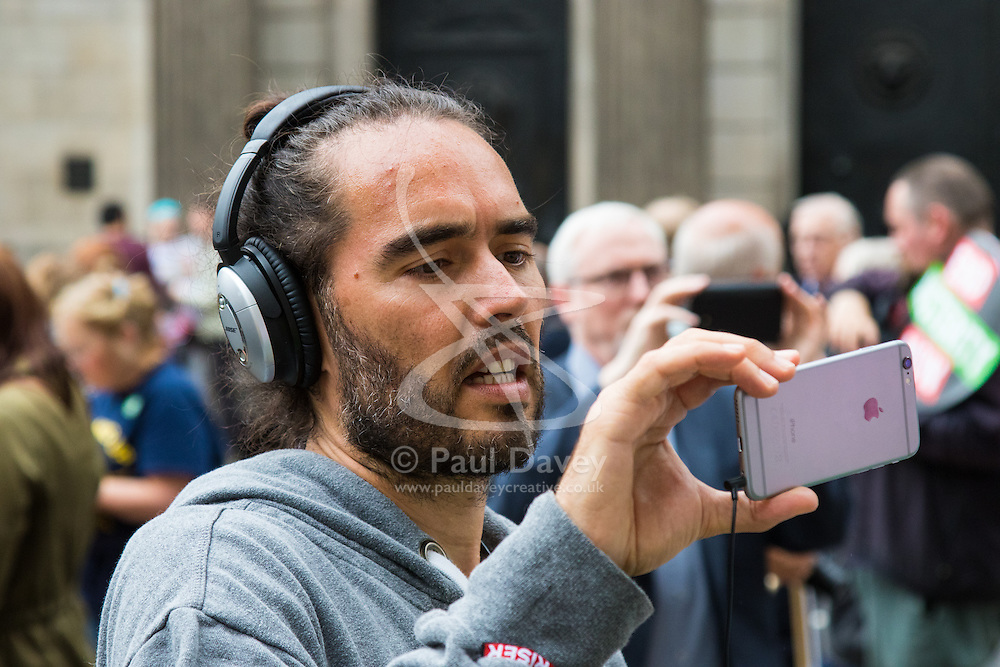 London, June 20th 2015. Thousands of people converge on the streets of London to join the People's Assembly Against Austerity's march from the Bank of England to Parliament Square. PICTURED: Comedian and activist Russel Brand films for his YouTube channel The Trews.  //Contact for image Licencing: Paul@pauldaveycreative.co.uk Tel:07966016296