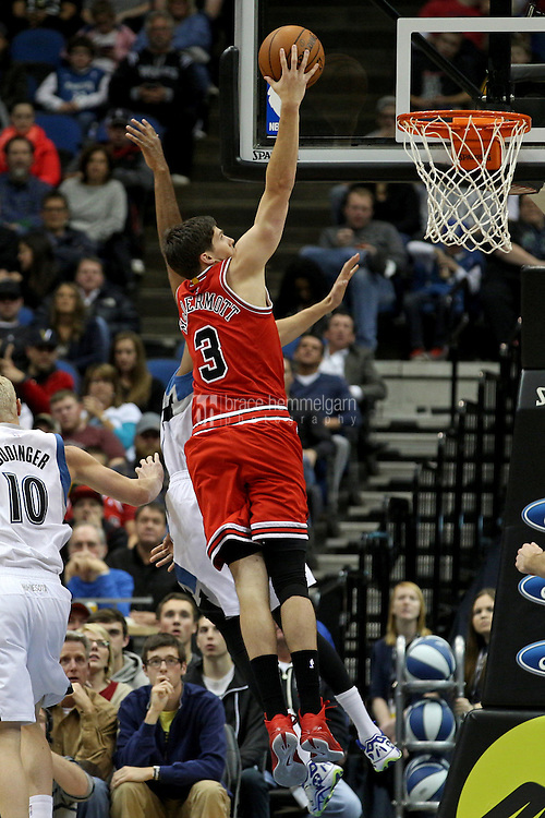 Nov 1, 2014; Minneapolis, MN, USA; Chicago Bulls forward Doug McDermott (3) shoots during the fourth quarter against the Minnesota Timberwolves at Target Center. The Bulls defeated the Timberwolves 106-105. Mandatory Credit: Brace Hemmelgarn-USA TODAY Sports