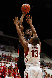 Nov 28, 2011; Stanford CA, USA;  Pacific Tigers forward Khalil Kelley (back) shoots over Stanford Cardinal forward/center Josh Owens (13) during the first half at Maples Pavilion.  Mandatory Credit: Jason O. Watson-US PRESSWIRE