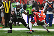 Carolina Panthers Wide Receiver D. J. Moore (12) holds off Tampa Bay Buccaneers Defensive Back Vernon Hargreaves (28) during the International Series match between Tampa Bay Buccaneers and Carolina Panthers at Tottenham Hotspur Stadium, London, United Kingdom on 13 October 2019.