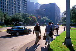 Stock photo of pedestrians walking down the sidewalk in downtown Houston Texas