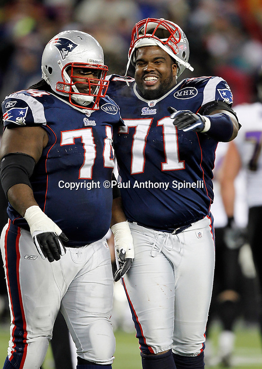 New England Patriots defensive tackle Kyle Love (74) and Patriots defensive end Brandon Deaderick (71) celebrate at the end of the AFC Championship NFL football game against the Baltimore Ravens on Sunday, January 22, 2012 in Foxborough, Massachusetts. The Patriots won the game 23-20. ©Paul Anthony Spinelli