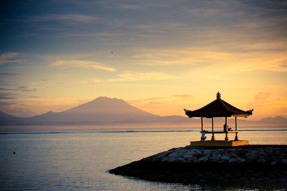 Early morning at the beach of Sanur, Bali. The mountain in the background is the volcano Gunung Agung.