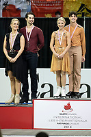 KELOWNA, BC - OCTOBER 26: Ice dance silver medalists, Madison Hubbell and Zachary Donohue of the United States, and gold medalists Piper Gilles and Paul Poirier of Canada stand on the podium during medal ceremonies of Skate Canada International held at Prospera Place on October 26, 2019 in Kelowna, Canada. (Photo by Marissa Baecker/Shoot the Breeze)