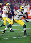 Green Bay Packers tackle Bryan Bulaga (75) pass blocks during the NFL NFC Divisional round playoff football game against the Arizona Cardinals on Saturday, Jan. 16, 2016 in Glendale, Ariz. The Cardinals won the game in overtime 26-20. (©Paul Anthony Spinelli)