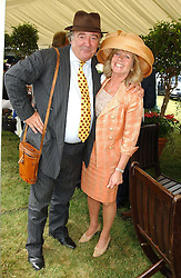SIR DAI LLEWELLYN and INGRID SEWARD at Ladies Day at Epsom Racecourse, Surrey during the Derby Festival on 3rd June 2005.<br /><br />NON EXCLUSIVE - WORLD RIGHTS