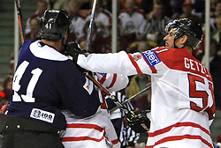 Raitis Ivanans and Ryan Getzlaf at fight  at ice-hockey match Canada vs Latvia (with replika jerseys from year 1936) at Preliminary Round (group B) of IIHF WC 2008 in Halifax, on May 04, 2008 in Metro Center, Halifax, Nova Scotia, Canada. (Photo by Vid Ponikvar / Sportal Images)
