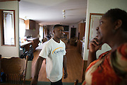 BEAUFORT, SC - JULY 14: CJ Cummings, center, listens to his mother Savasha Cummings in their home on July 14, 2014 in Beaufort, South Carolina.  Cummings is a 14-year-old power lifter who has been lauded as the next great home for an American weightlifting medal at the Olympics. (Photo by Stephen B. Morton for The Washington Post)