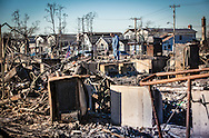 Breezy Point, New York, November 6, 2012, A  man on the site where 111 homes burnt to the ground when Hurricane Sandy hit.