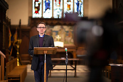 © Licensed to London News Pictures.22/03/2020. London, UK. Eddie Scrase-Field ,Vicar at St John's in Blackheath, delivers a live streamed sermon to an empty church .Churches and other places of worship are looking for different ways of reaching and supporting the community during the Coronavirus outbreak. Photo credit: George Cracknell Wright/LNP