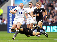 © Andrew Fosker / Seconds Left Images 2010 - England's Mike Tindall tries to escape form the diving New Zealand's Richie McCaw (Captain) as England v New Zealand All Blacks - Investec Challenge Series - 06/11/2010 - Twickenham Stadium  - London - All rights reserved..