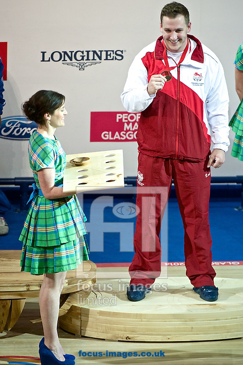 Ben Watson of England pictured after winning the bronze medal in the Men's 105kg final on Weightlifting Day Seven at Clyde Auditorium during Glasgow 2014 Commonwealth Games <br /> Picture by Ian Wadkins/Focus Images Ltd +44 7877 568959<br /> 30/07/2014