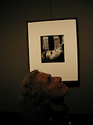 Savita Brandt, niece of Bill Brandt underneath the photograph of her taken in 1955, ' Portrait of a young girl, Belgravia 1955'. ONE TIME USE ONLY - DO NOT ARCHIVE  © Copyright Photograph by Dafydd Jones 66 Stockwell Park Rd. London SW9 0DA Tel 020 7733 0108 www.dafjones.com