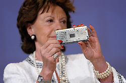 Neelie Kroes, the EU's competition commissioner, displays an Intel X86 CPU during a news conference, in Brussels, Belgium, on Wednesday, May 13, 2009. Intel Corp., the world's biggest computer-chip maker, was fined a record 1.06 billion euros ($1.45 billion) by the European Union for using rebates to thwart competitors. .(Photo © Jock Fistick)