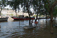 Paris . Flooding . The Seine river at the quay de la Tournelle, in the distance saint Louis island