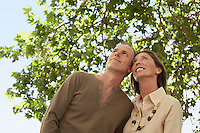 Tourist Couple standing under tree looking at view low angle view