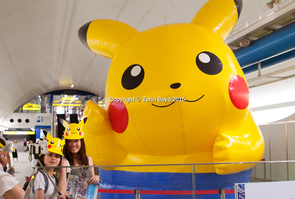 August 7, 2016, Yokohama, Japan: This is Pikachu Outbreak!, a weeklong extravaganza dedicated to Pikachu, the lovable Pokemon character held in Yokohama from August 7 -14, 2016. This annual summer event started in 2014 involves hundreds of Pikachu mascots and huge inflatables making appearances at venues throughout the city's waterfront district known as Minato Mirai. Events include a parade of dancing Pikachu mascots, a large gathering of Pikachu splashing themselves and fans, a hula dance event, a Pikachu fishing pool, stage performances, Pikachu merchandise for sale and Pikachu photo studios. (Torin Boyd/Polaris).