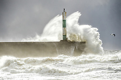 © Licensed to London News Pictures. 29/01/2015. Aberystwyth, UK UK Weather:  High winds and tides bring stormy seas to batter the sea defense at Aberystwyth on the west Wales coast. Much of the UK has been affected by cold wintry weather today, with heavy snow causing traffic and transport disruption in many places, and 'yellow warnings' for snow and ice as far as the south west of England. Photo credit : Keith Morris/LNP