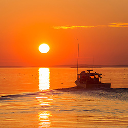 Lobster boat at sunrise in a harbor in South Thomaston, Maine.
