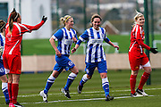 Charlotte Gurr celebrates her goal during the FA Women's Premier League match between Brighton Ladies and Cardiff City Ladies at Brighton's Training Ground, Lancing, United Kingdom on 22 March 2015. Photo by Geoff Penn.