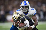 NEW ORLEANS, LA - OCTOBER 15:  Jarrad Davis #40 of the Detroit Lions tackles Alvin Kamara #41 of the New Orleans Saints at Mercedes-Benz Superdome on October 15, 2017 in New Orleans, Louisiana.  The Saints defeated the Lions 52-38.  (Photo by Wesley Hitt/Getty Images) *** Local Caption *** Jarrad Davis; Alvin Kamara