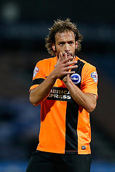 Inigo Calderon of Brighton claps the away fans after the match ends in a 1-1 draw - Photo mandatory by-line: Rogan Thomson/JMP - 07966 386802 - 21/10/2014 - SPORT - FOOTBALL - Huddersfield, England - The John Smith's Stadium - Huddersfield Town v Brighton & Hove Albion - Sky Bet Championship.
