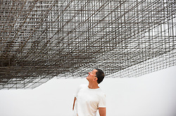"""© Licensed to London News Pictures. 16/09/2019. LONDON, UK.  Antony Gormley RA poses next to his work """"Matrix III"""", 2019.  Preview of a new exhibition by Antony Gormley at the Royal Academy of Arts.  The show bring together existing and specially conceived new works from drawing to sculptures to experimental environments to be displayed in all 13 rooms of the RA's Main Galleries 21 September to 3 December 2019.  Photo credit: Stephen Chung/LNP"""