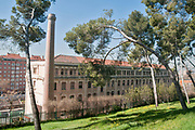 Old factory with brick chimney. Photographed in Madrid, Spain