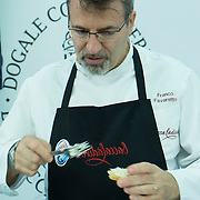 Chef Franco Favaretto prepares a Baccala Mantecato on some bread  at Biennale del Gusto on October 28, 2013 in Venice, Italy. The Biennale del Gusto is an exhibition held over four days, dedicated to traditional food and drinks from all regions of Italy.