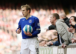 Phil Neville of Everton receives abuse from Liverpool fans