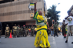 JOHANNESBURG, SOUTH AFRICA – APRIL 07: MKMVA, ANCYL and ANC members gather outside Luthuli House in support of the ANC and Zuma amidst calls for President Zuma to step down, in Johannesburg, South Africa, 07 April 2017. Businesses closed and South Africans from numerous political, religious, labour and civic groups gathered at central points across the entire country protesting against President Zuma's recent government reshuffle appointing 10 new ministers and 10 new deputy ministers including the axing of the finance minister. Photo: Dino Lloyd