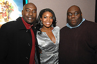"Morris Chestnut, Gabrielle Union and Faizon Love arriving for a screening of the movie, ""A Perfect Holiday"" in Washington, DC on December 4, 2007"