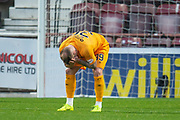 Gregg Wylde (#39) of Livingston FC has his head in his hands after missing a golden chance during the 4th round of the William Hill Scottish Cup match between Heart of Midlothian and Livingston at Tynecastle Stadium, Edinburgh, Scotland on 20 January 2019.