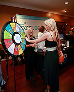 Woman visits the Excel Dental booth at 417 Magazine's 2014 Indulge Event.