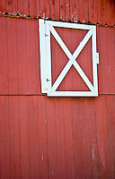 Long Island, New York. West Hampton - side view of a red barn.