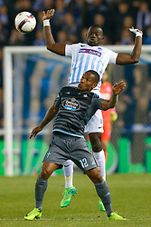 April 20, 2017 - Genk, BELGIUM - Celta's Claudio Beauvue and Genk's Omar Colley fight for the ball during the return leg of quarterfinals in the Europa League competition between Belgian soccer team RC Genk and Spanish team Celta Vigo, Thursday 20 April 2017, in Genk. First leg ended on a 2-3 result in Spain. BELGA PHOTO BRUNO FAHY (Credit Image: © Bruno Fahy/Belga via ZUMA Press)